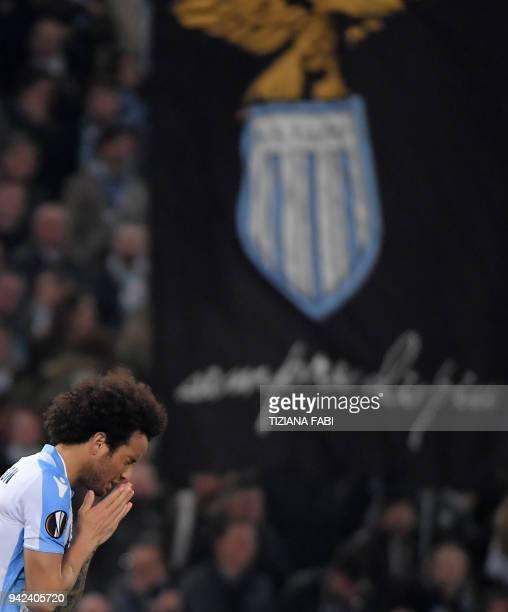 Lazio's midfielder from Brazil Felipe Anderson celebrates after scoring during the UEFA Europa League quarter final first leg football match between...