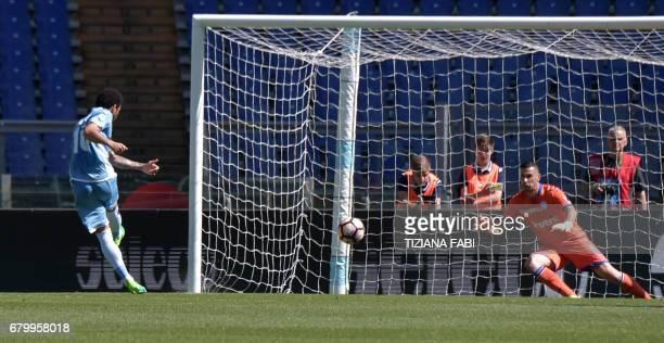 Lazio's midfielder from Brazil Felipe Anderson kicks and scores a penalty during the Italian Serie A football match Lazio vs Sampdoria at the Olympic...
