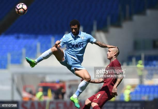 TOPSHOT Lazio's midfielder from Brazil Felipe Anderson vies with Roma's midfielder from Belgium Radja Nainggolan during the Italian Serie A football...