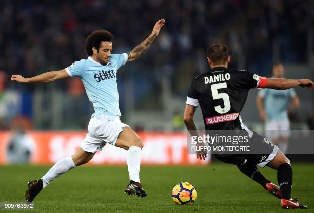Lazio's midfielder from Brazil Felipe Anderson vies with Udinese's defender from Brazil Danilo during the Italian Serie A football match between...
