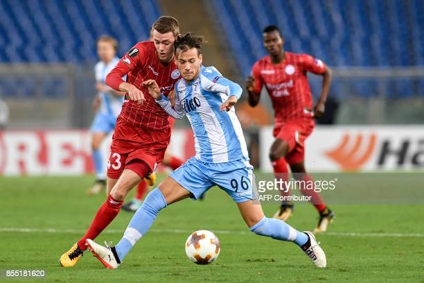 Lazio's midfielder from Italy Alessandro Murgia fights for the ball with ZulteWaregem's midfielder from Belgium Sander Coopman during the UEFA Europa...