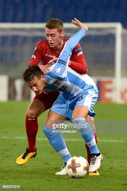 Lazio's midfielder from Italy Alessandro Murgia vies with ZulteWaregem's midfielder from Belgium Sander Coopman during the UEFA Europa League...