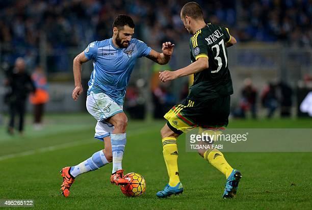 Lazio's midfielder from Italy Antonio Candreva vies with AC Milan's defender from Italy Luca Antonelli during the Italian Serie A football match...