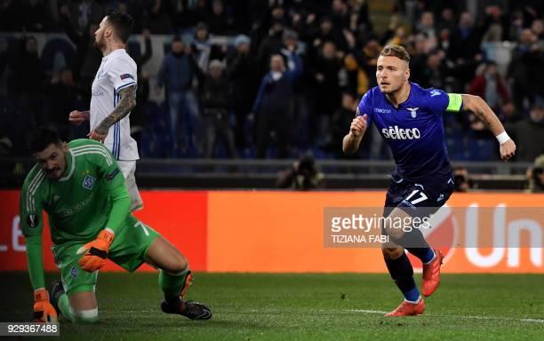 Lazio's midfielder from Italy Ciro Immobile celebrates after scoring during the UEFA Europa League round 16 firstleg football match SS Lazio vs...