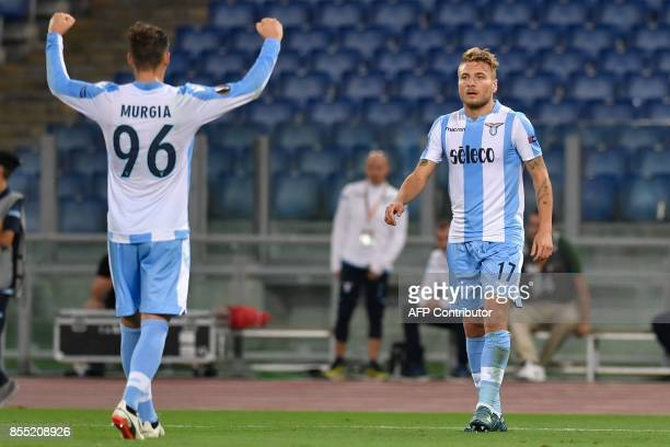Lazio's midfielder from Italy Ciro Immobile celebrates with teammate Alessandro Murgia after scoring during the UEFA Europa League football match...