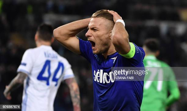Lazio's midfielder from Italy Ciro Immobile reacts during the UEFA Europa League round 16 firstleg football match SS Lazio vs Dynamo Kyiv on March 8...