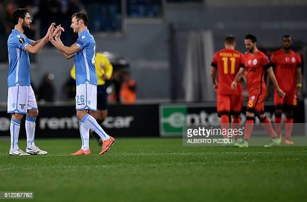 Lazio's midfielder from Italy Marco Parolo and Lazio's defender from Romania Stefan Radu celebrates at the end of the UEFA Europa League football...