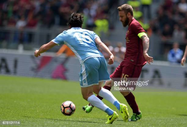 Lazio's midfielder from Italy Marco Parolo fights for the ball with Roma's midfielder from Italy Daniele De Rossi during the Italian Serie A football...
