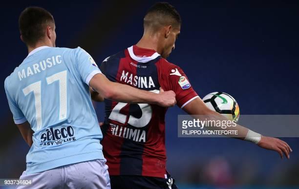 Lazio's midfielder from Montenegro Adam Marusic vies with Bologna's forward Adam Masina during the Italian Serie A football match Lazio vs Bologna at...
