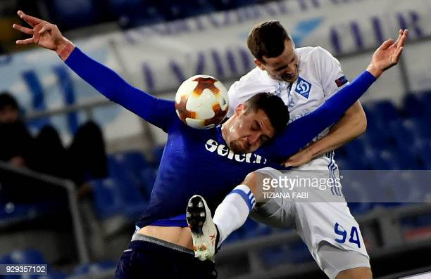 Lazio's midfielder from Serbia Sergej MilinkovicSavic fights for the ball whith Dynamo's Tomasz Kedziora during the UEFA Europa League round 16...