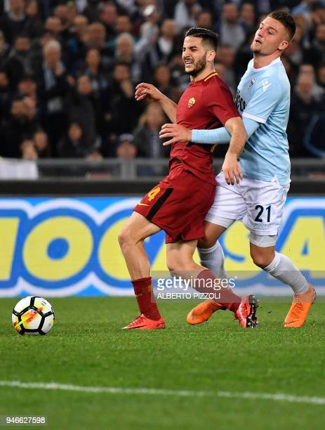 Lazio's midfielder from Serbia Sergej MilinkovicSavic vies for the ball with Roma's defender from Greece Kostas Manolas during the Italian Serie A...