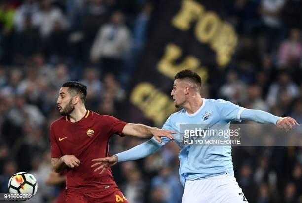 Lazio's midfielder from Serbia Sergej MilinkovicSavic vies with Roma's defender from Greece Kostas Manolas during the Italian Serie A football match...