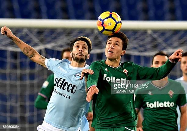 Lazio's midfielder from Spain Luis Alberto fights for the ball with Fiorentina's Italian midfielder Federico Chiesa during the Italian Serie A...