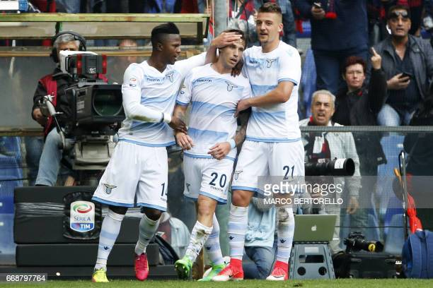 Lazio's midfielder Lucas Biglia from Argentina celebrates after scoring with teammates Lazio's midfielder Sergej MilinkovicSavic from Serbia and...