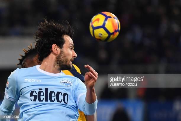 Lazio's midfielder Marco Parolo heads the ball during the Italian Serie A football match Lazio vs Hellas Verona on February 19 2018 at Olympic...