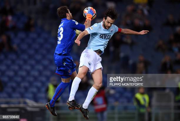 Lazio's midfielder Marco Parolo vies with Bologna's goalkeeper Antonio Mirante during the Italian Serie A football match Lazio vs Bologna at the...