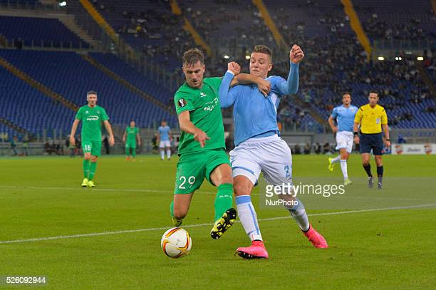 Lazio's midfielder Sergej Milinkovic Savic fights for the ball with St Etienne's forward Francois Clerc during the Europe League football match SS...