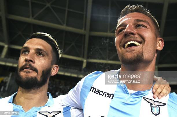 Lazio's midfielder Sergej MilinkovicSavic from Serbia celebrates after scoring with Lazio's forward Luis Alberto Romero Alconchel from Spain during...