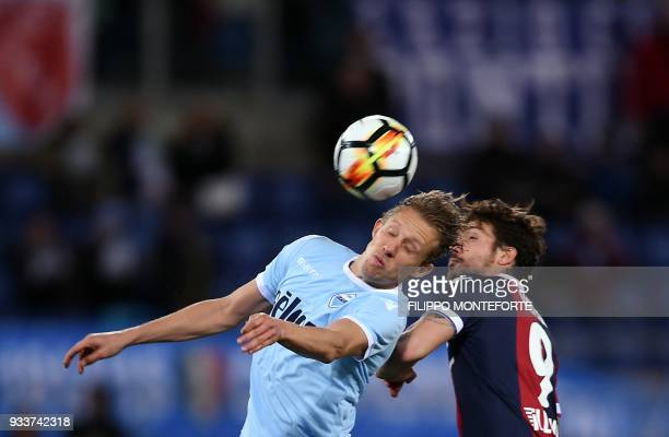 Lazio's midfieleder from Brazil Lucas Leiva vies with Bologna's forward Simone Verdi during the Italian Serie A football match Lazio vs Bologna at...