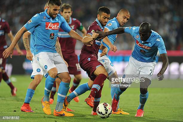 Lazio's player Felipe Anderson vies with SSC Napoli player David Lopez and Kalidou Koulibaly during the Serie A match between SSC Napoli and SS Lazio...