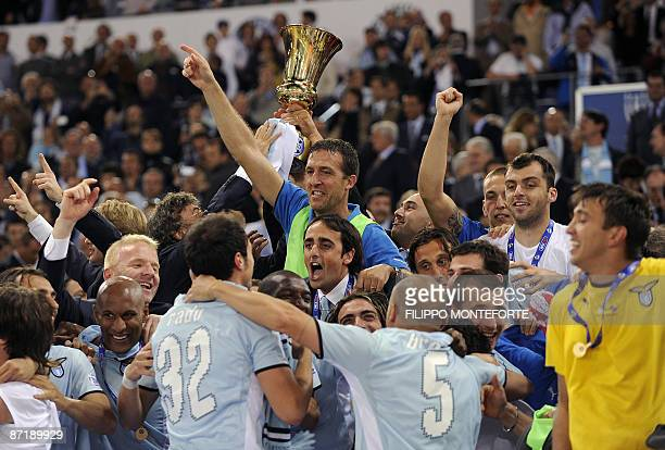 Lazio's players and team celebrate after winning the Italian Cup on May 13 2009 at Rome's Olympic Stadium Lazio beat Sampdoria 65 on penalties...