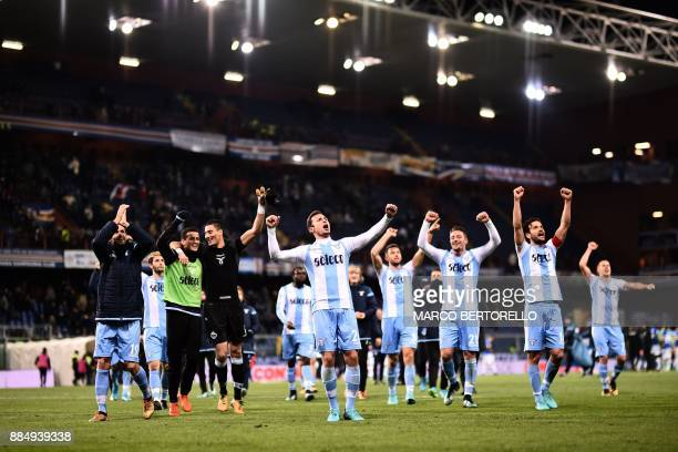 Lazio's players celebrate after winning the Italian Serie A football match Sampdoria Vs Lazio on December 3 2017 at the 'Luigi Ferraris stadium' in...