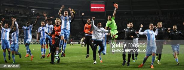Lazio's players celebrate at the end of the Italian Serie A football match Torino vs Lazio on April 29 2018 at the 'Grande Torino Stadium' in Turin
