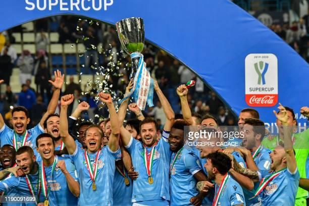 Lazio's players lift the trophy following the Supercoppa Italiana final football match between Juventus and Lazio at the King Saud University Stadium...