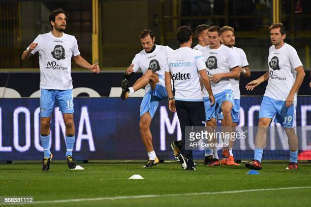 Lazio's players wearing tshirts against antisemitism showing an image of holocaust victim Anne Frank warm up prior the Italian Serie A football match...