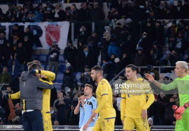 Lazio's Romanian defender Stefan Radu and Serbian midfielder Sergej MilinkovicSavic react at the end of the Italian Serie A football match between...