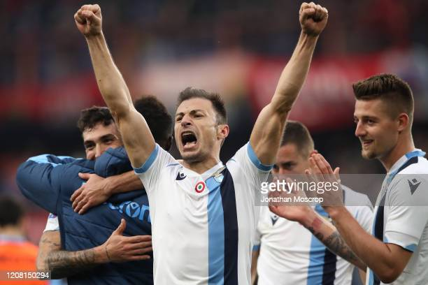 Lazio's Romanian defender Stefan Radu celebrates after the final whistle of during the Serie A match between Genoa CFC and SS Lazio at Stadio Luigi...