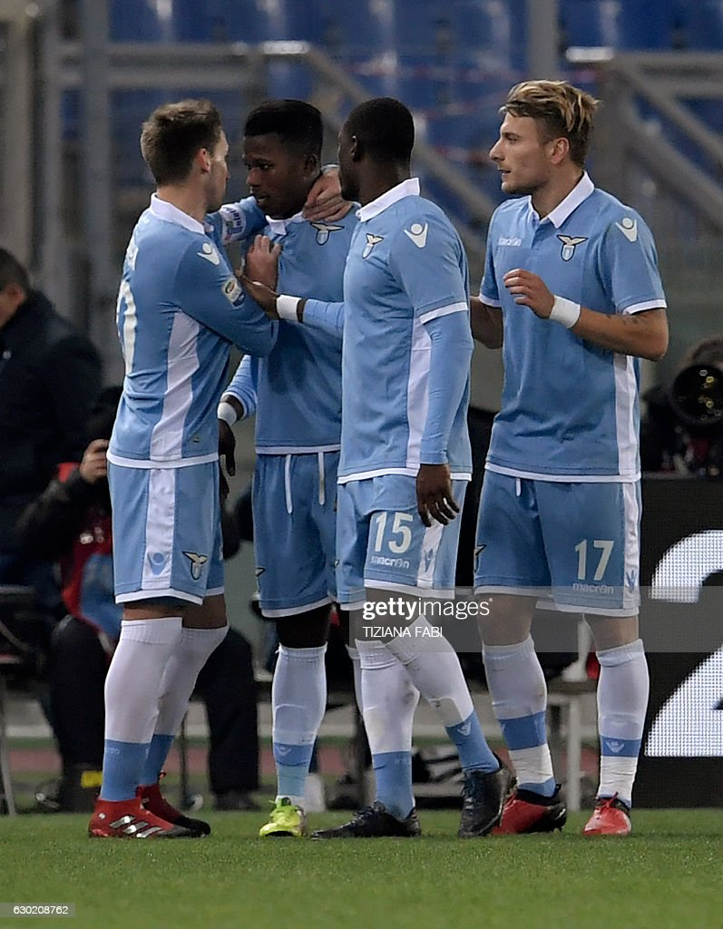 Lazio's Senegalese forward Balde Diao Keita (2ndL) celebrates with teammates after scoring a goal during the Serie A football match between Lazio and Fiorentina at Olympic Stadium in Rome on December 18, 2016. / AFP / TIZIANA