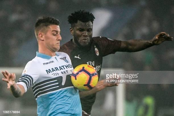 Lazio's Serbian midfielder Sergej MilinkovicSavic and AC Milan's Ivorian midfielder Franck Kessie go for the ball during the Italian Serie A football...