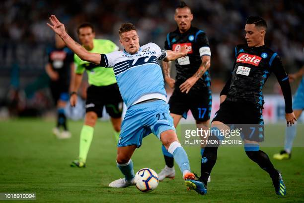 Lazio's Serbian midfielder Sergej MilinkovicSavic and Napoli's Spanish forward Jose Callejon go for the ball during the Italian Serie A football...