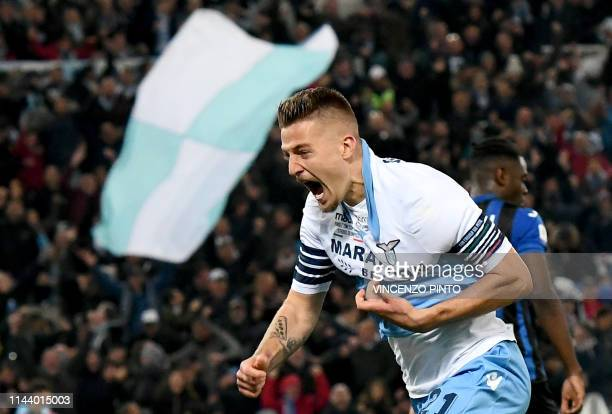 TOPSHOT Lazio's Serbian midfielder Sergej MilinkovicSavic celebrates after scoring a goal during the Coppa Italia final match between Lazio and...