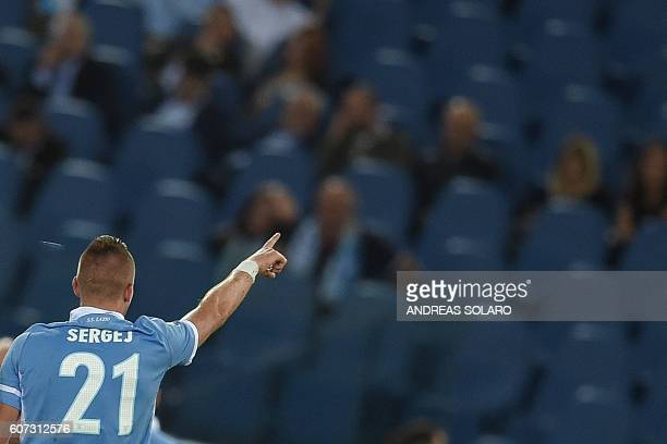 Lazio's Serbian midfielder Sergej MilinkovicSavic celebrates after scoring a goal during the Italian Serie A football match Lazio vs Pescara on...