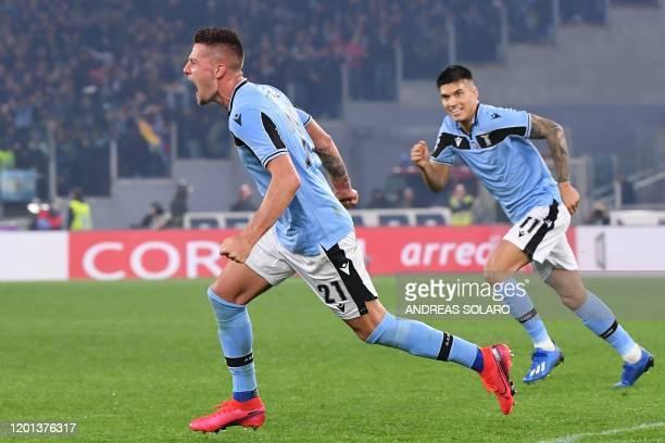 Lazio's Serbian midfielder Sergej Milinkovic-Savic celebrates after scoring during the Italian Serie A football match Lazio Rome vs Inter Milan on...