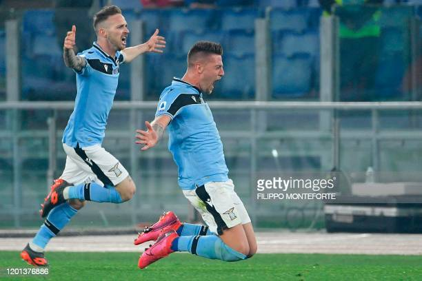Lazio's Serbian midfielder Sergej MilinkovicSavic celebrates after scoring during the Italian Serie A football match Lazio Rome vs Inter Milan on...