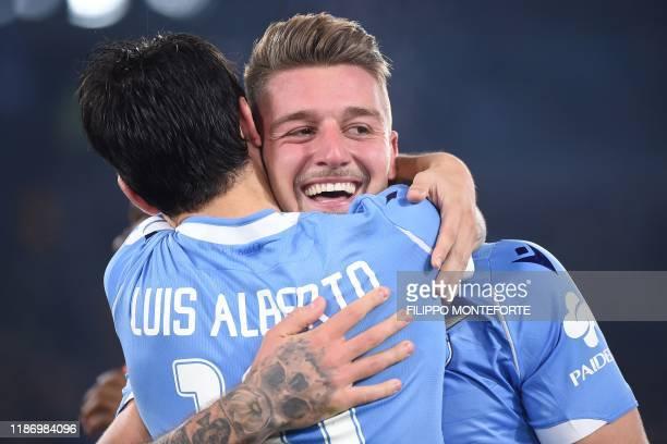 Lazio's Serbian midfielder Sergej MilinkovicSavic celebrates with Lazio's Spanish midfielder Luis Alberto after scoring during the Italian Serie A...