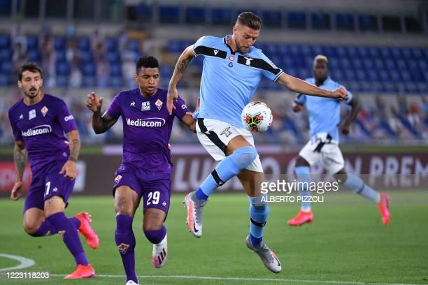 Lazio's Serbian midfielder Sergej MilinkovicSavic controls the ball ahead of Fiorentina's Brazilian defender Dalbert during the Italian Serie A...