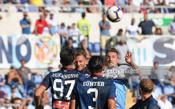 Lazio's Serbian midfielder Sergej MilinkovicSavic eyes the ball during the Italian Serie A football match between SS Lazio and Genoa CFC at the...