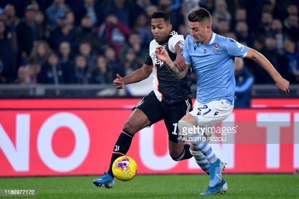 Lazio's Serbian midfielder Sergej MilinkovicSavic outruns Juventus' Brazilian defender Alex Sandro during the Italian Serie A football match lazio...