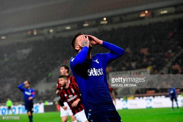 Lazio's Serbian midfielder Sergej MilinkovicSavic reacts after missing to score during the Italian Serie A football match between AC Milan and Lazio...