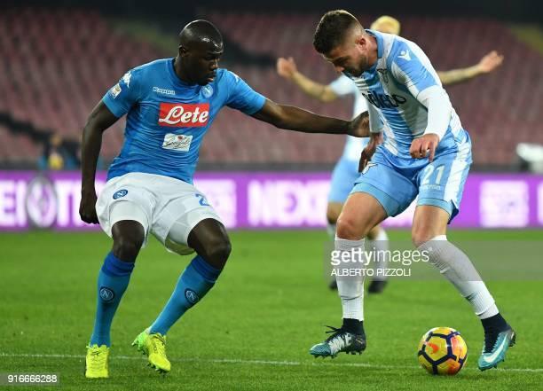 Lazio's Serbian midfielder Sergej MilinkovicSavic vies for the ball with Napoli's French defender Kalidou Koulibaly during the Italian Serie A...