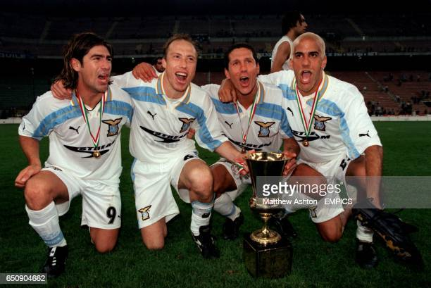 Lazio's South American contingent celebrate with the Coppa Italia Marcelo Salas Roberto Nestor Sensini Diego Simeone and Juan Sebastian Veron