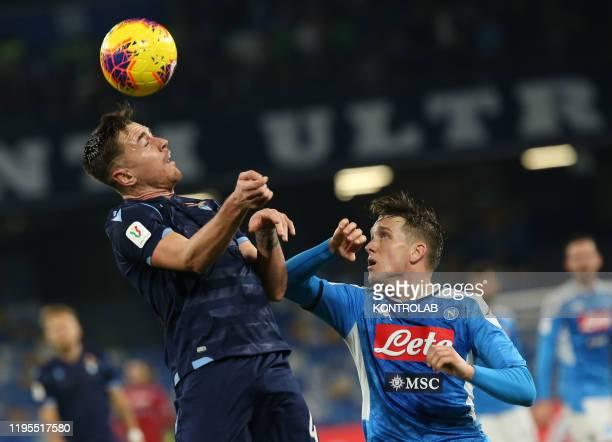 STADIUM NAPLES CAMPANIA ITALY Lazio's Spanish defender Patric heads the ball as fighting with Napoli's Polish midfielder Piotr Zielinski during the...
