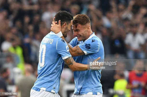 Lazio's Spanish midfielder Luis Alberto celebrates with his teammate after scoring during the Italian Serie A football match between Lazio Roma and...