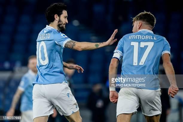 Lazio's Spanish midfielder Luis Alberto celebrates with Lazio's Italian forward Ciro Immobile after scoring during the Italian Serie A football match...
