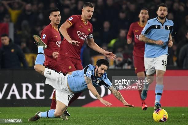 Lazio's Spanish midfielder Luis Alberto collides with AS Roma's Bosnian forward Edin Dzeko during the Italian Serie A football match Roma vs Lazio on...