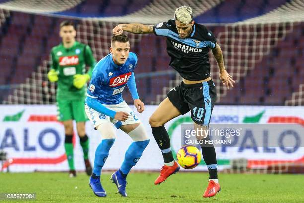 Lazio's Spanish midfielder Luis Alberto controls the ball under pressure from Napoli's Polish midfielder Piotr Zielinski during the Italian Serie A...